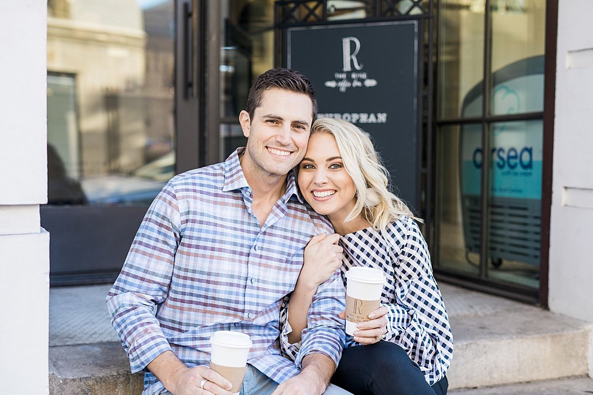 Man and woman holding coffee outside of Charleston coffee shop The Rise