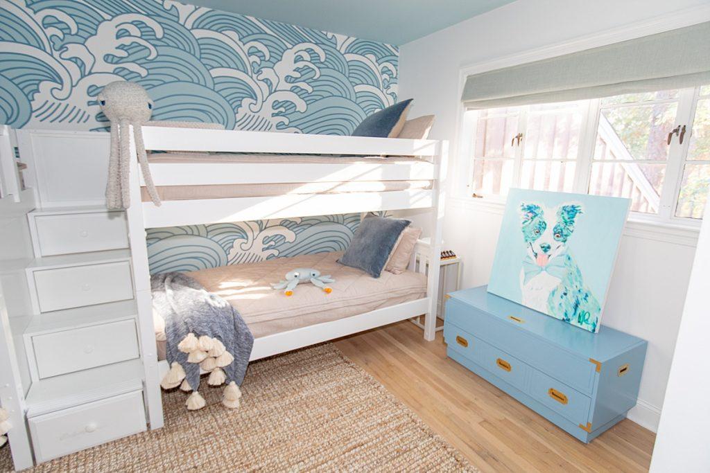 Quadruple bunk beds in boy's surf themed room