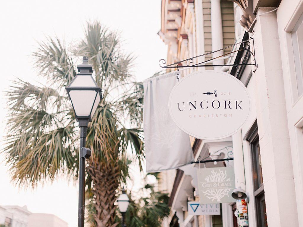 Sign for Uncork Charleston, a wine bar on Upper King Street in Charleston