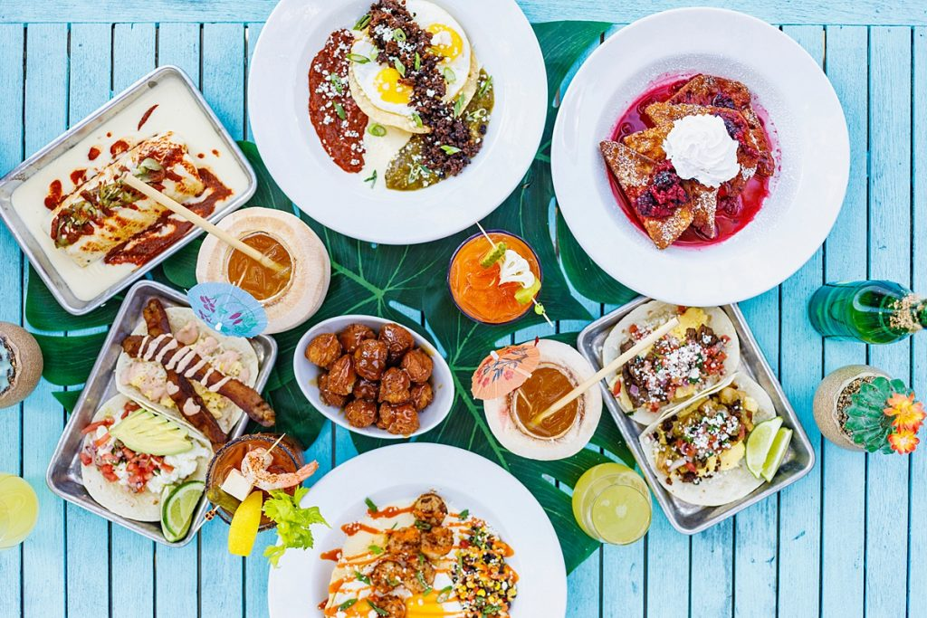 Display of brunch dishes at Mex 1 Coastal Cantina in Charleston on turquoise table