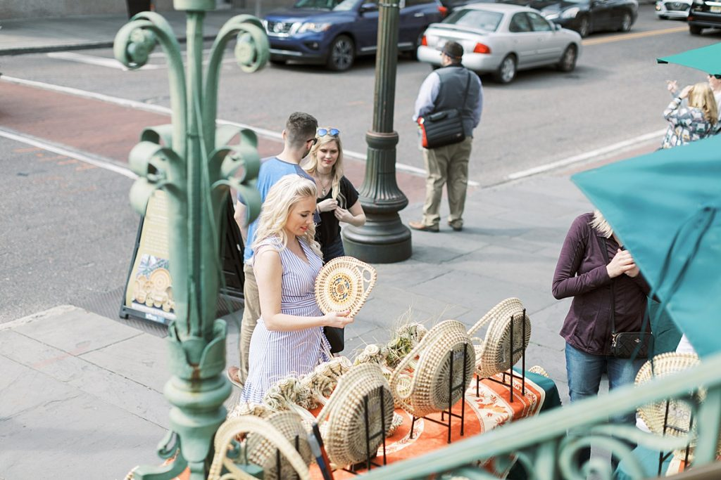Looking at sweetgrass baskets outside of the Historic City Market in Charleston, South Carolina