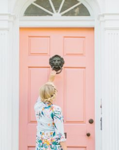 Woman using door knocker
