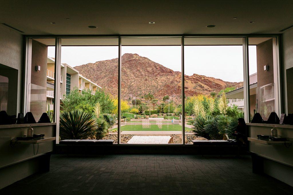 View of Camelback Mountain through floor-to-ceiling windows of Mountain Shadows Resort