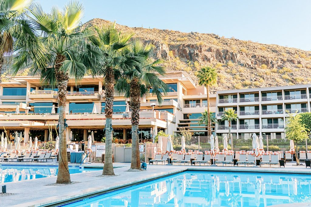 Exterior view of the Phoenician Resort, top recommended hotel for the Phoenix Travel Guide, showing pools and pool deck